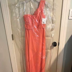 Long coral color bridesmaid/formal dress.